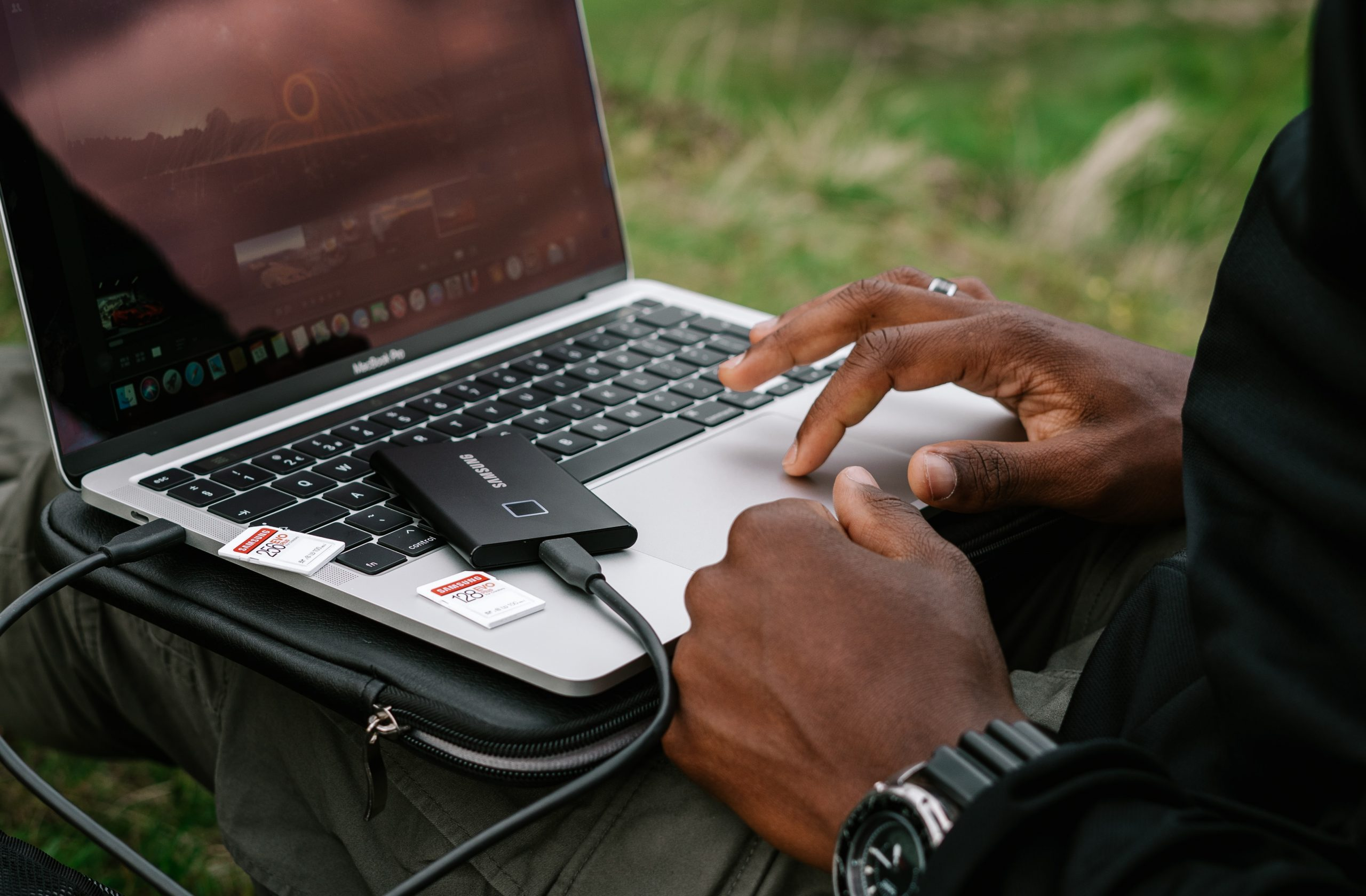 person using gray asus laptop computer